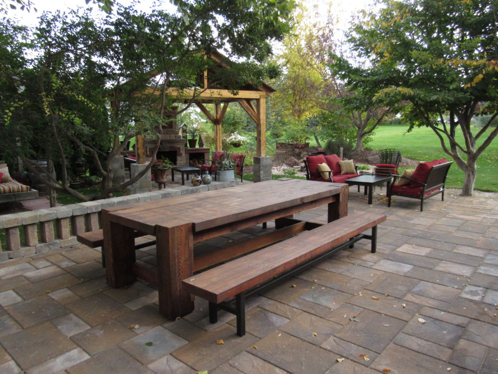 Rustic wood picnic table on patio
